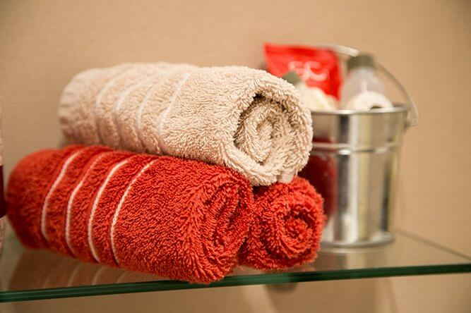Closeup of rolled facecloths in bathroom