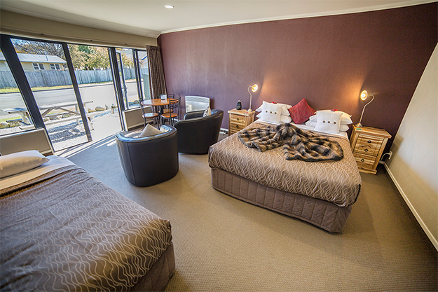 Two beds and seating area in studio style accommodation