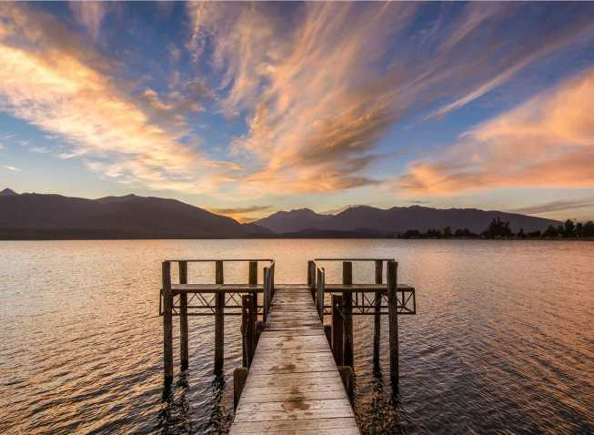 Lake Te Anau sunset with wharf in foreground